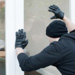 locksmith peterborough burglar looking though window