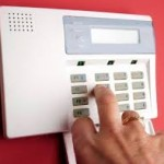 locksmith plymouth alarm panel red wall